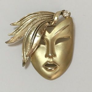 Vintage 80s gold face pin with rhinestone